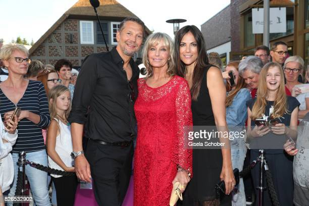 Kai Wiesinger Bo Derek and Bettina Zimmermann during the late night shopping at Designer Outlet Soltau on August 4 2017 in Soltau Germany
