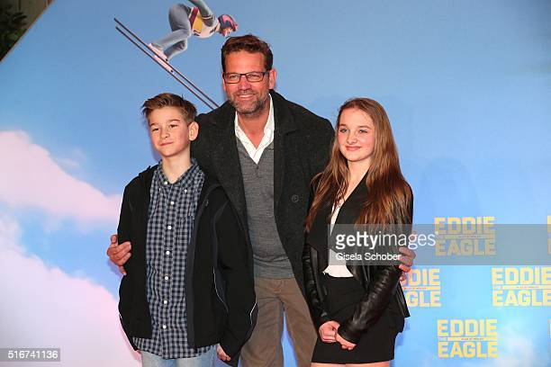 Kai Woersching and his son Luca and a friend Sophie during the 'Eddie the Eagle' premiere at Mathaeser Filmpalast on March 20 2016 in Munich Germany