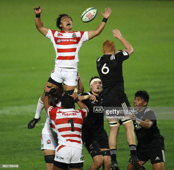 Kai Yamamoto of Japan attempts to catch the ball during the World Rugby U20 Championship match between New Zealand and Japan at Stade d'Honneur du...