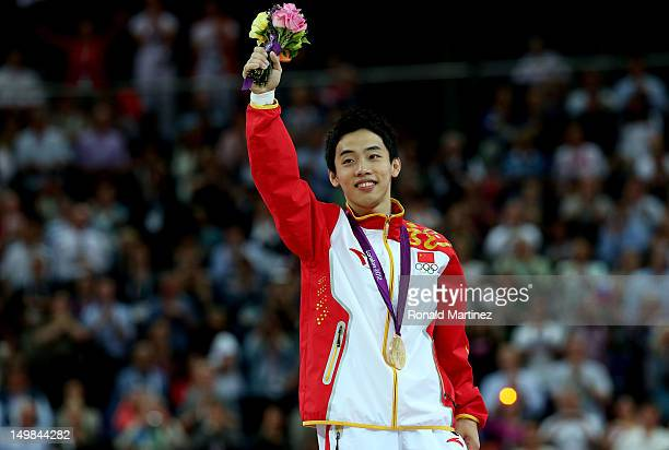 Kai Zou of China celebrates with his gold medal during the medal ceremony for the Artistic Gymnastics Men's Floor Exercise final on Day 9 of the...