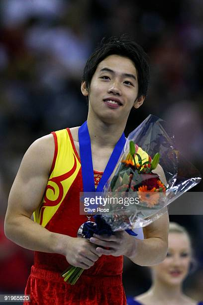 Kai Zou of China poses after he came third in the floor exercise event during the Apparatus Finals on the fifth day of the Artistic Gymnastics World...
