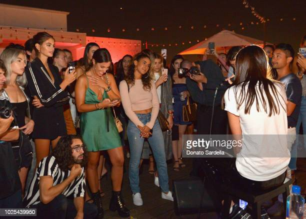 Kaia Gerber and guests watch Charlotte Lawrence perform at the KARL LAGERFELD x KAIA launch with REVOLVE hosted by Kaia Gerber at Revolve Social Club...