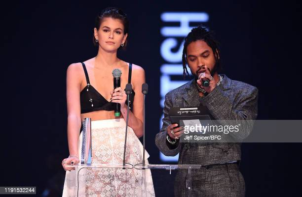 Kaia Gerber and Miguel present an award on stage during The Fashion Awards 2019 held at Royal Albert Hall on December 02 2019 in London England