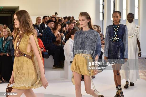 Kaia Gerber and models walk the runway during the Chloe show finale as part of the Paris Fashion Week Womenswear Spring/Summer 2019 on September 27,...
