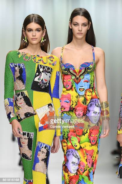 Kaia Gerber and Vittoria Ceretti walk the runway at the Versace show during Milan Fashion Week Spring/Summer 2018 on September 22 2017 in Milan Italy