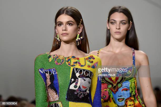 Kaia Gerber andVittoria Ceretti walk the runway at the Versace show during Milan Fashion Week Spring/Summer 2018 on September 22 2017 in Milan Italy