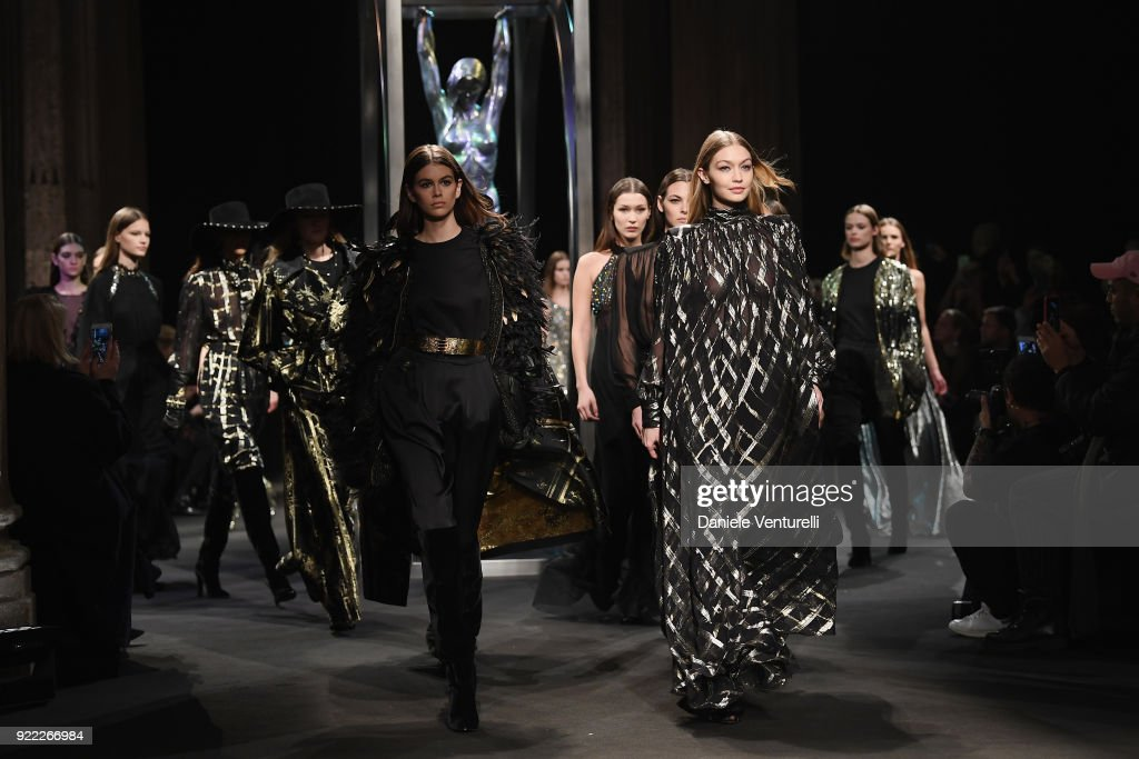 Kaia Gerber, Gigi Hadid and models walk the runway at the Alberta Ferretti show during Milan Fashion Week Fall/Winter 2018/19 on February 21, 2018 in Milan, Italy.