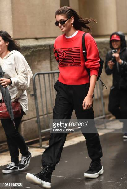 Kaia Gerber is seen wearing a Proenza Schouler red sweater with black sunglasses outside the Proenza Schouler show during New York Fashion Week...