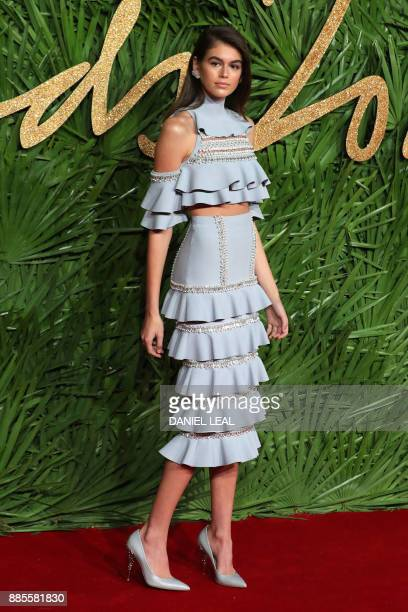 Kaia Gerber poses on the red carpet upon arrival to attend the British Fashion Awards 2017 in London on December 4 2017 / AFP PHOTO / Daniel...