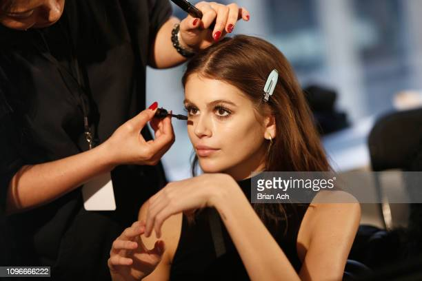Kaia Gerber prepares backstage at the Longchamp fashion show on February 2019 during New York Fashion Week on February 9, 2019 in New York City.