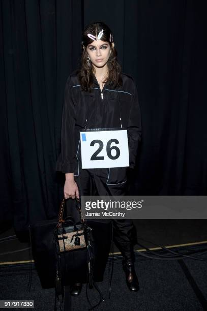 Kaia Gerber prepares backstage for Coach 1941 during New York Fashion Week at Basketball City on February 13 2018 in New York City
