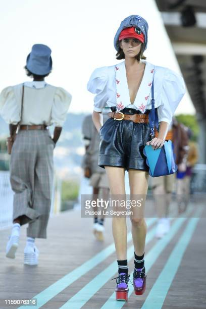 Kaia Gerber walks during the runway miu miu club show at Hippodrome d'Auteuil on June 29 2019 in Paris France
