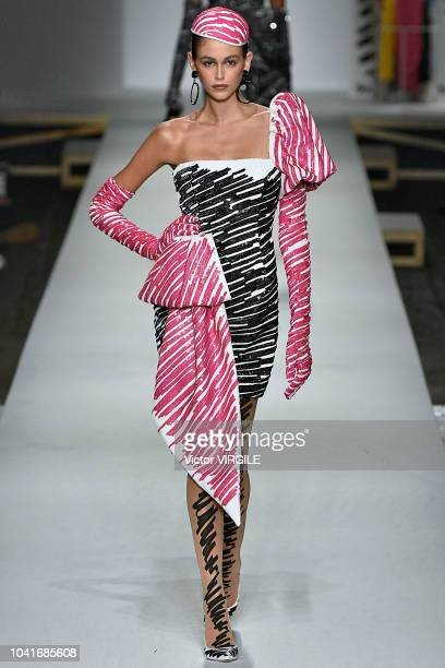 Kaia Gerber walks the runway at the Moschino Ready to Wear fashion show during Milan Fashion Week Spring/Summer 2019 on September 20 2018 in Milan...