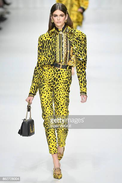 Kaia Gerber walks the runway at the Versace Ready to Wear Spring/Summer 2018 fashion show during Milan Fashion Week Spring/Summer 2018 on September...