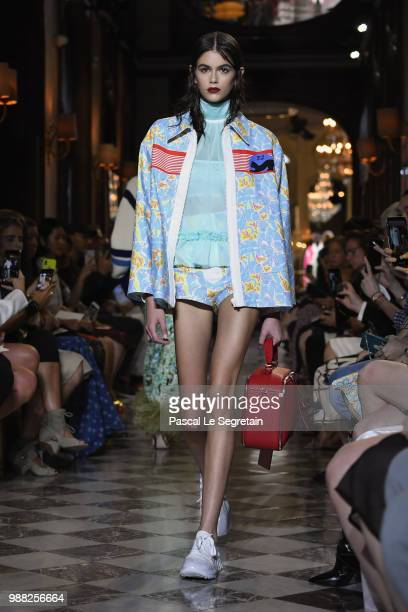 Kaia Gerber walks the runway during Miu Miu 2019 Cruise Collection Show at Hotel Regina on June 30 2018 in Paris France