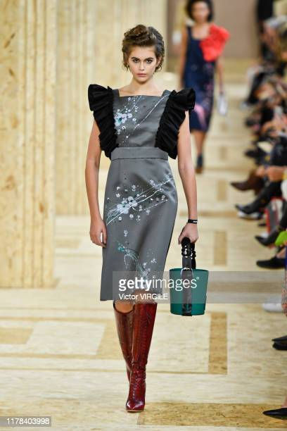Kaia Gerber walks the runway during the Miu Miu Ready to Wear Spring/Summer 2020 fashion show as part of Paris Fashion Week on October 01, 2019 in...
