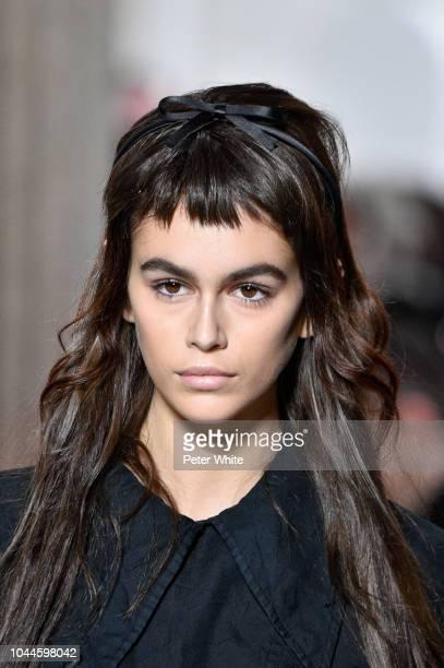 Kaia Gerber walks the runway during the Miu Miu show as part of the Paris Fashion Week Womenswear Spring/Summer 2019 on October 2, 2018 in Paris,...