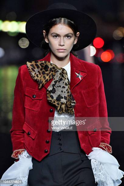 Kaia Gerber walks the runway during the Saint Laurent Ready to Wear fashion show as part of the Paris Fashion Week Womenswear Spring/Summer 2019 on...