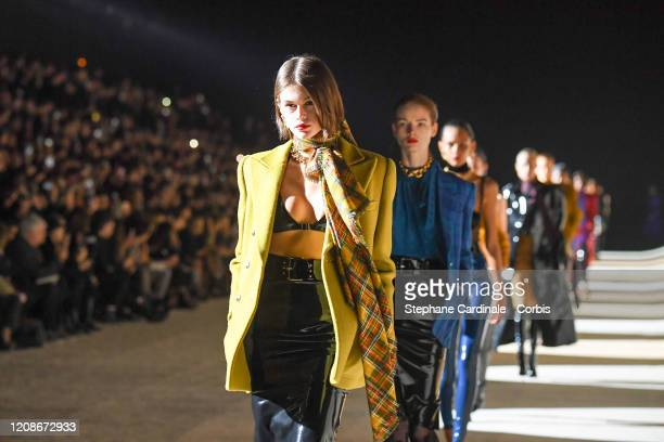 Kaia Gerber walks the runway during the Saint Laurent show as part of the Paris Fashion Week Womenswear Fall/Winter 2020/2021 on February 25, 2020 in...
