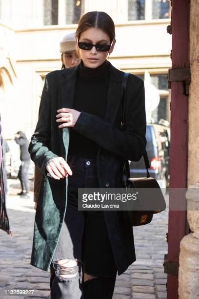 Kaia Gerber, wearing a black top, black ripped jeans, dark green blazer, white boots and black bag, is seen outside Lanvin on Day 3 Paris Fashion...