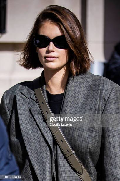 Kaia Gerber wearing a grey checked blazer is seen outside the Sacai show during Paris Fashion Week Womenswear Spring Summer 2020 on September 30 2019...