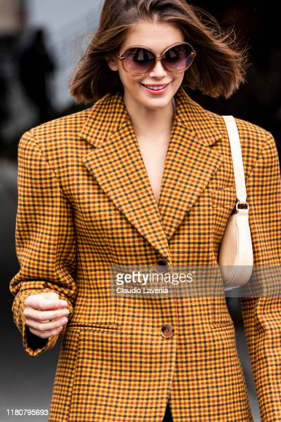 Kaia Gerber wearing an orange checked blazer is seen outside the Chanel show during Paris Fashion Week Womenswear Spring Summer 2020 on October 01...