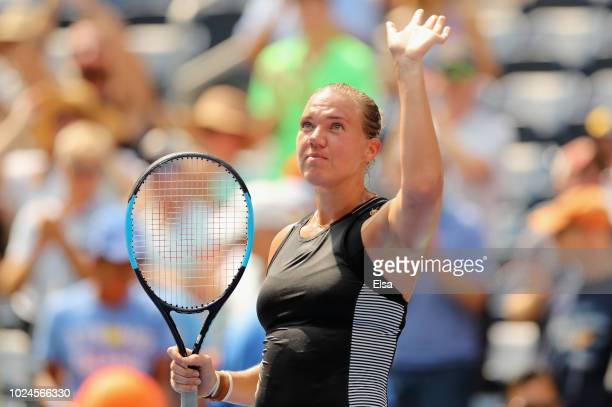Kaia Kanepi of Estonia celebrates her women's singles first round match victory against Simona Halep of Romania on Day One of the 2018 US Open at the...