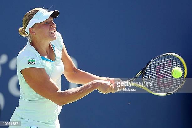Kaia Kanepi of Estonia hits a return against Vera Zvonareva of Russia during her women's singles quarterfinal match on day ten of the 2010 U.S. Open...