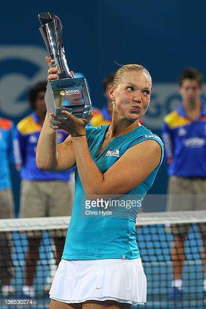 Kaia Kanepi of Estonia holds the Yvonne Goolagong trophy after winning the Womens final against Daniela Hantuchova of Slovakia during day seven of...