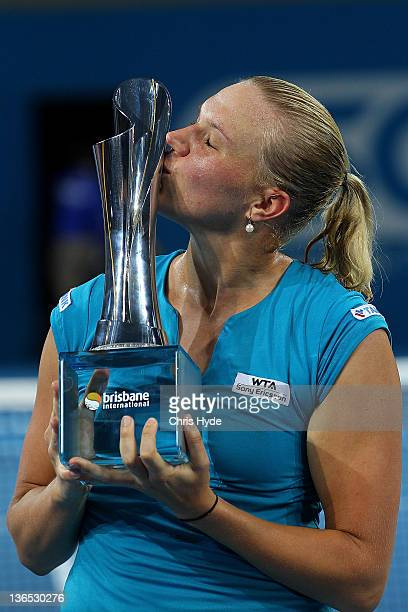 Kaia Kanepi of Estonia kisses the Yvonne Goolagong trophy after winning the Womens final against Daniela Hantuchova of Slovakia during day seven of...
