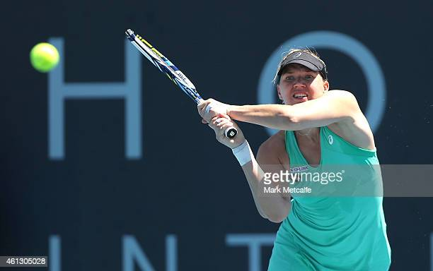Kaia Kanepi of Estonia plays a backhand in her first round match against Monica Puig of Puerto Rico during day one of the 2015 Hobart International...