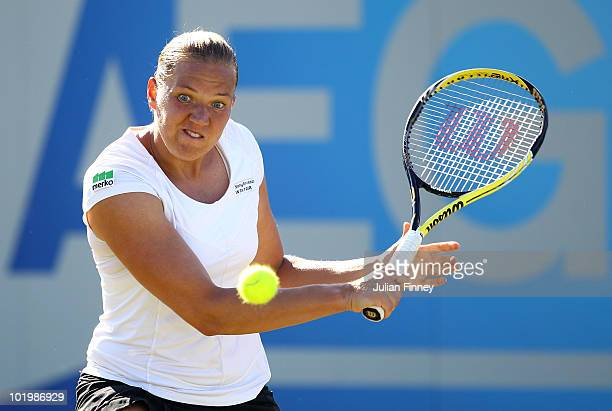 Kaia Kanepi of Estonia plays a backhand in her match against Na Li of China in the Women's Singles during the AEGON Classic Tennis at the Edgbaston...