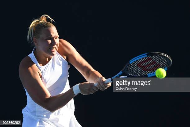 Kaia Kanepi of Estonia plays a backhand in her second round match against Monica Puig of Puerto Rico on day three of the 2018 Australian Open at...