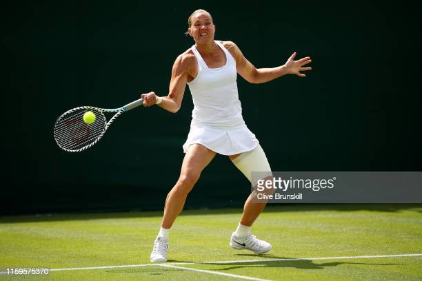Kaia Kanepi of Estonia plays a forehand in her Ladies' Singles first round match against Stefanie Voegele of Switzerland during Day two of The...