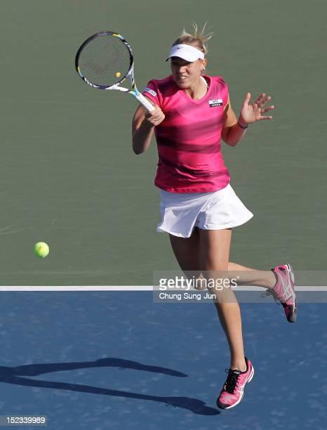 Kaia Kanepi of Estonia plays a shot against Galina Voskoboeva of Kazakhstan during day two of the KDB Korea Open at Olympic Park Tennis Stadium on...