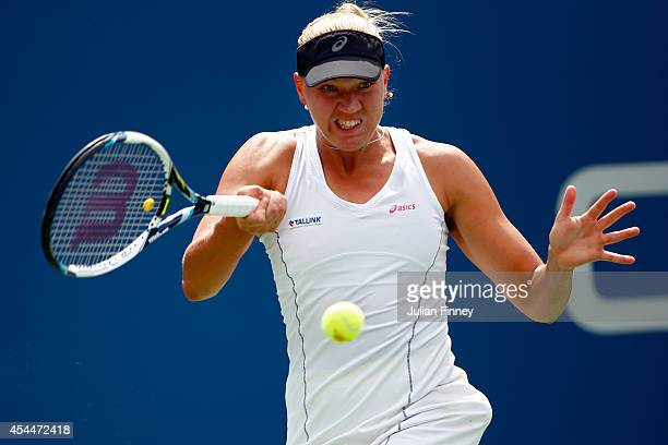 Kaia Kanepi of Estonia returns a shot against Serena Williams of the United States during their women's singles fourth round match on Day Eight of...