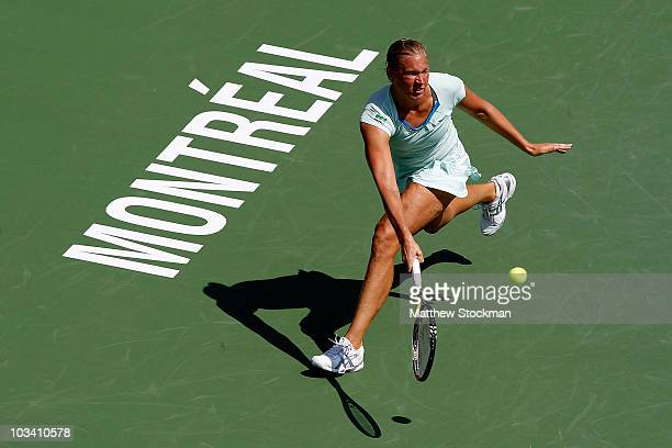 Kaia Kanepi of Estonia returns a shot to Shahar Peer of Israel during the Rogers Cup at Stade Uniprix on August 16 2010 in Montreal Canada