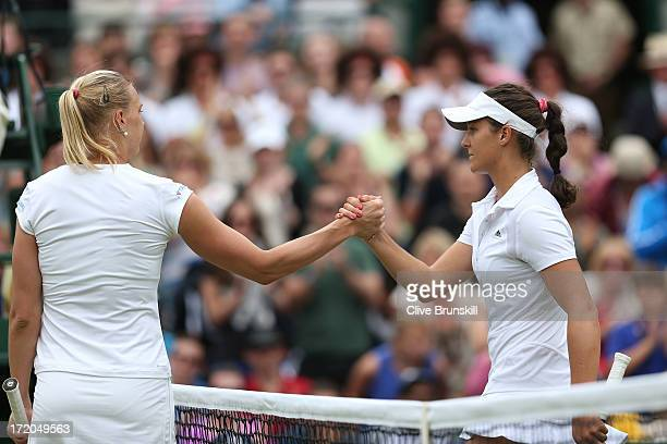 Kaia Kanepi of Estonia shakes hands at the net with Laura Robson of Great Britain after their Ladies' Singles fourth round match on day seven of the...