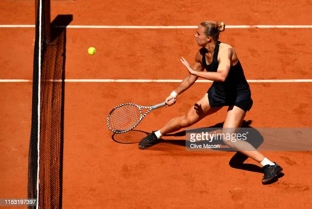 Kaia Kanepi of Estonia volleys during her ladies singles fourth round match against Petra Martic of Croatia during Day eight of the 2019 French Open...