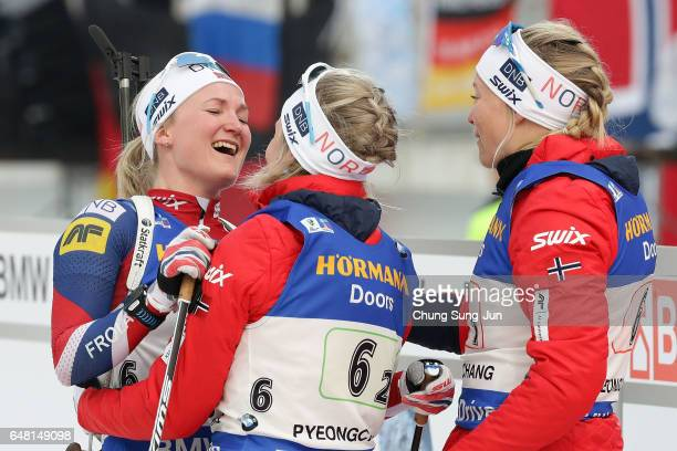 Kaia Woeien Nicolaisen Hilde Fenne Tiril Eckhoff and Marte Olsbu of Norway celebrate after the Women's 4x6km relay during the BMW IBU World Cup...