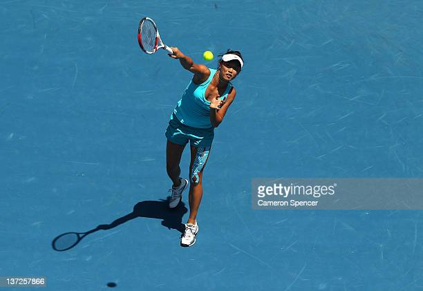 KaiChen Chang of Chinese Taipei plays a smash shot in her second round match against Jelena Jankovic of Serbia during day three of the 2012...