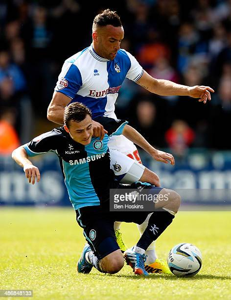Kaid Mohamed of Bristol battles with Josh Scowen of Wycombe during the Sky Bet League Two match between Wycombe Wanderers and Bristol Rovers at Adams...