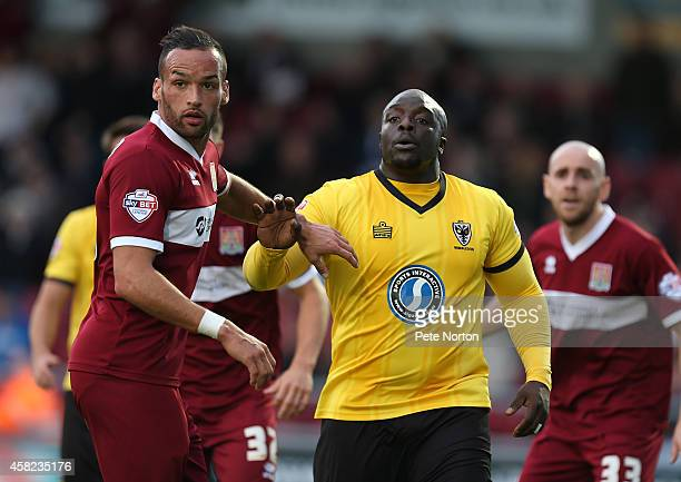Kaid Mohamed of Northampton Town and Adebayo Akinfenwa look on during the Sky Bet League Two match between Northampton Town ans AFC Wimbledon at...