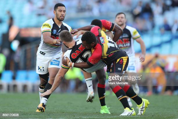 Kaide Ellis of the Panthers is tackled during the 2017 State Championship Final between the Penrith Panthers and Papua New Guinea Hunters at ANZ...