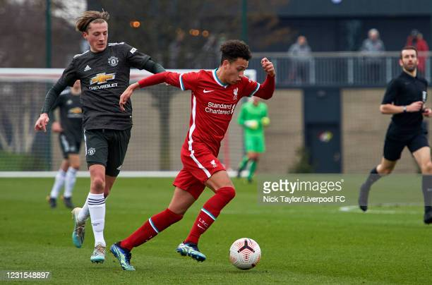 Kaide Gordon of Liverpool and Charlie Savage of Manchester United in action during the U18 Premier League game between Liverpool and Manchester...