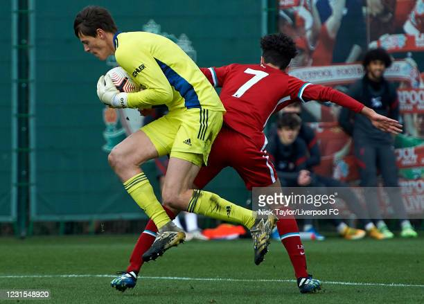 Kaide Gordon of Liverpool and Redek Vitek of Manchester United in action during the U18 Premier League game between Liverpool and Manchester United...