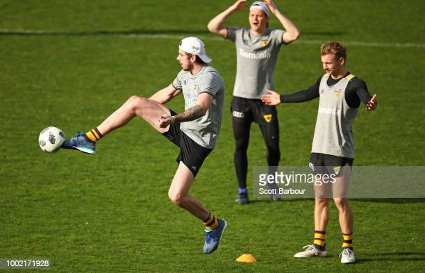 Kaiden Brand of the Hawks kicks a soccer ball during a Hawthorn Hawks AFL training session at Waverley Park on July 20 2018 in Melbourne Australia