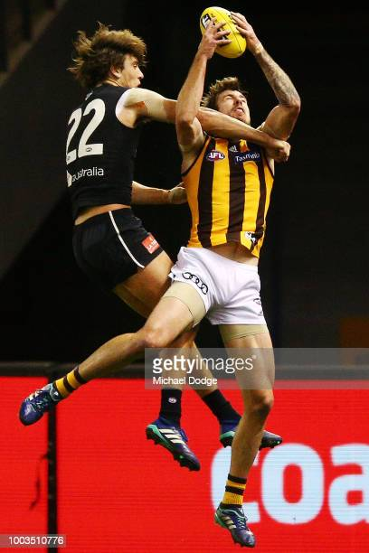 Tom Mitchell of the Hawks holds the David Parkin Medal for the best one round during the 2018 AFL round 18 match between the Carlton Blues and the...