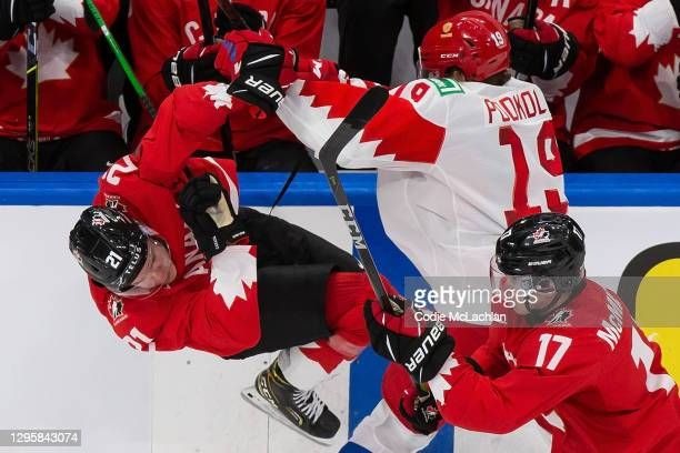 Kaiden Guhle of Canada skates against Vasili Podkolzin of Russia during the 2021 IIHF World Junior Championship semifinals at Rogers Place on January...