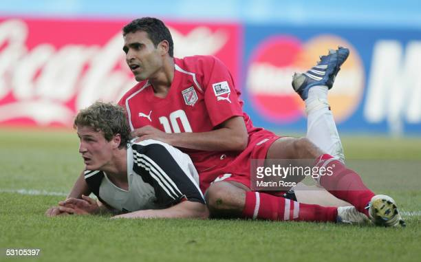 Kaies Ghodhbane of Tunisia tackles Robert Huth of Germany during the FIFA Confederations Cup match between Tunisia and Germany on June 18 2005 in...
